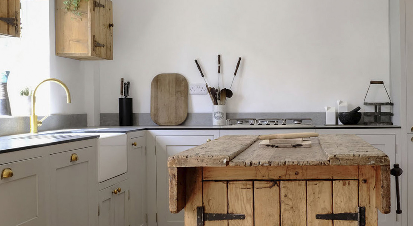 Light grey shaker kitchen by Olive & Barr with wooden island and cupboards