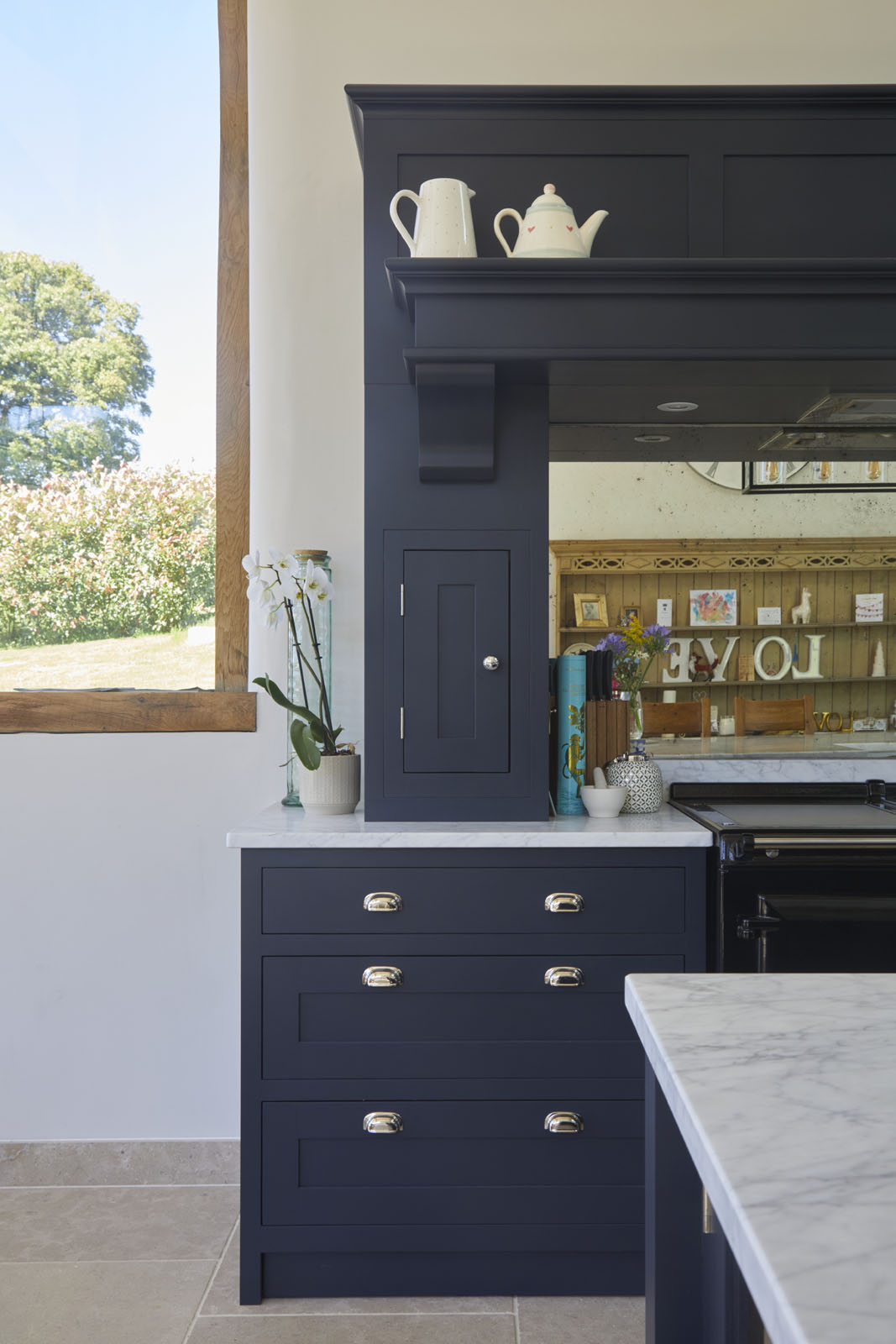 Blue shaker kitchen with gold handles