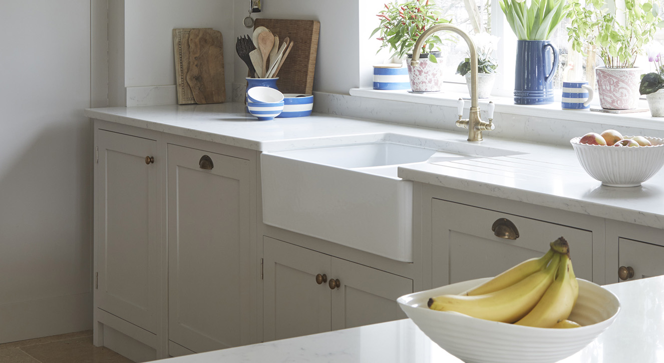 Light grey Shaker Kitchen by Olive & Barr with stone worktops.