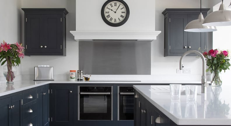 Striking dark grey shaker kitchen with stone worktops and Island