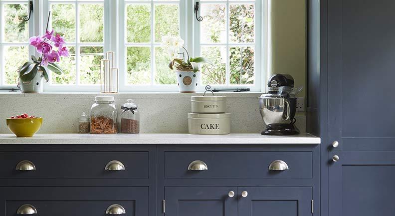Close up of dark grey shaker kitchen with stone worktops