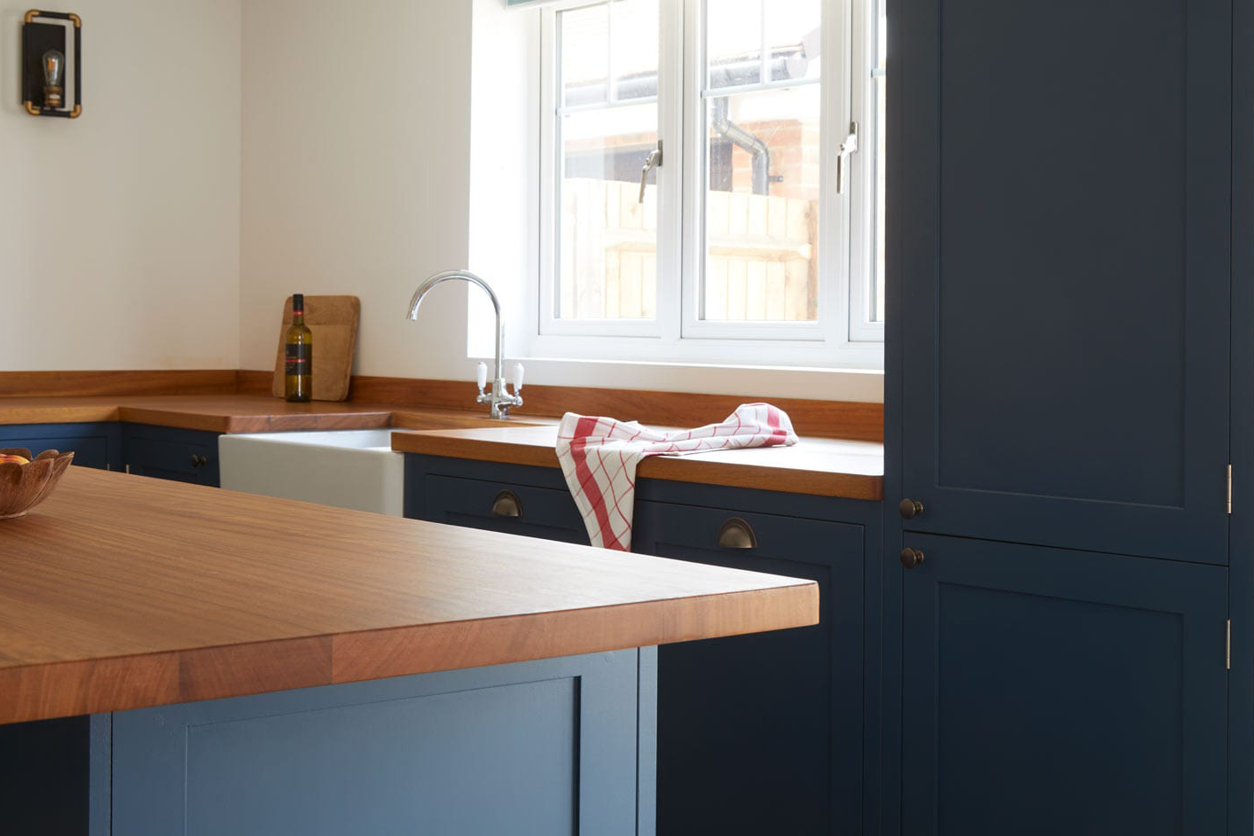 Grey Shaker kitchen with wooden worktops and Island.