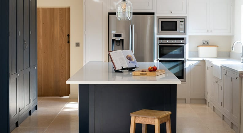 Dark and light grey shaker kitchen with island feature and white stone worktops
