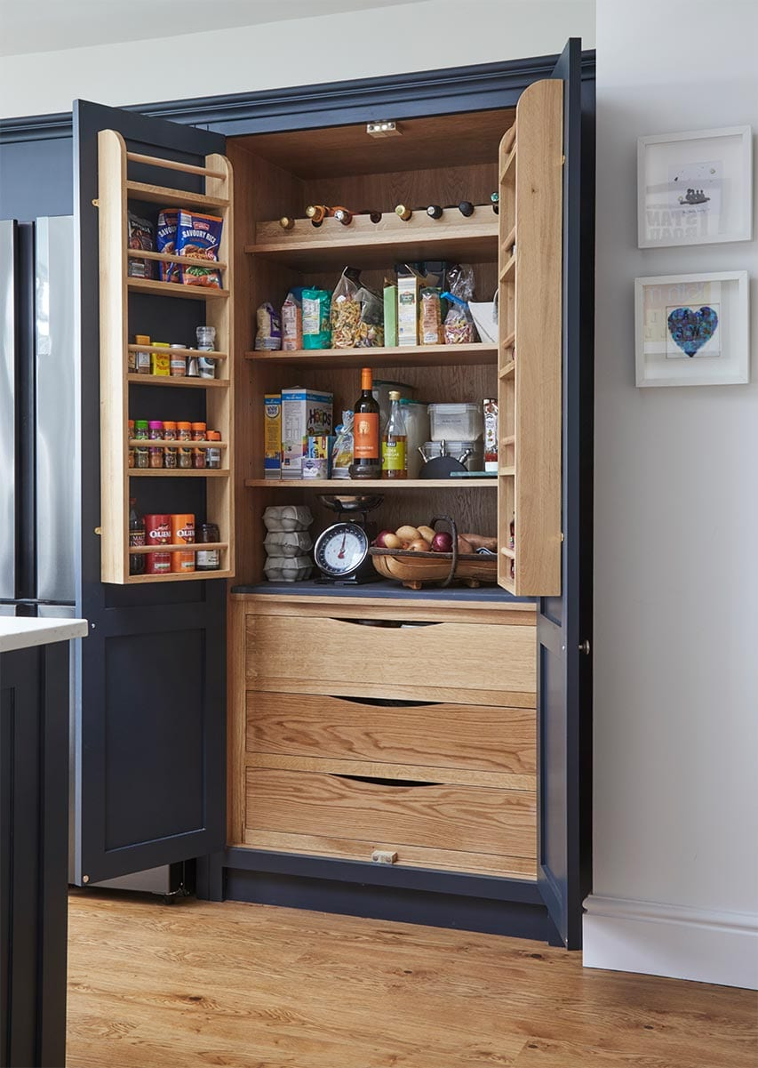 Dark Blue shaker kitchen with bespoke cabinetry and cupboards open