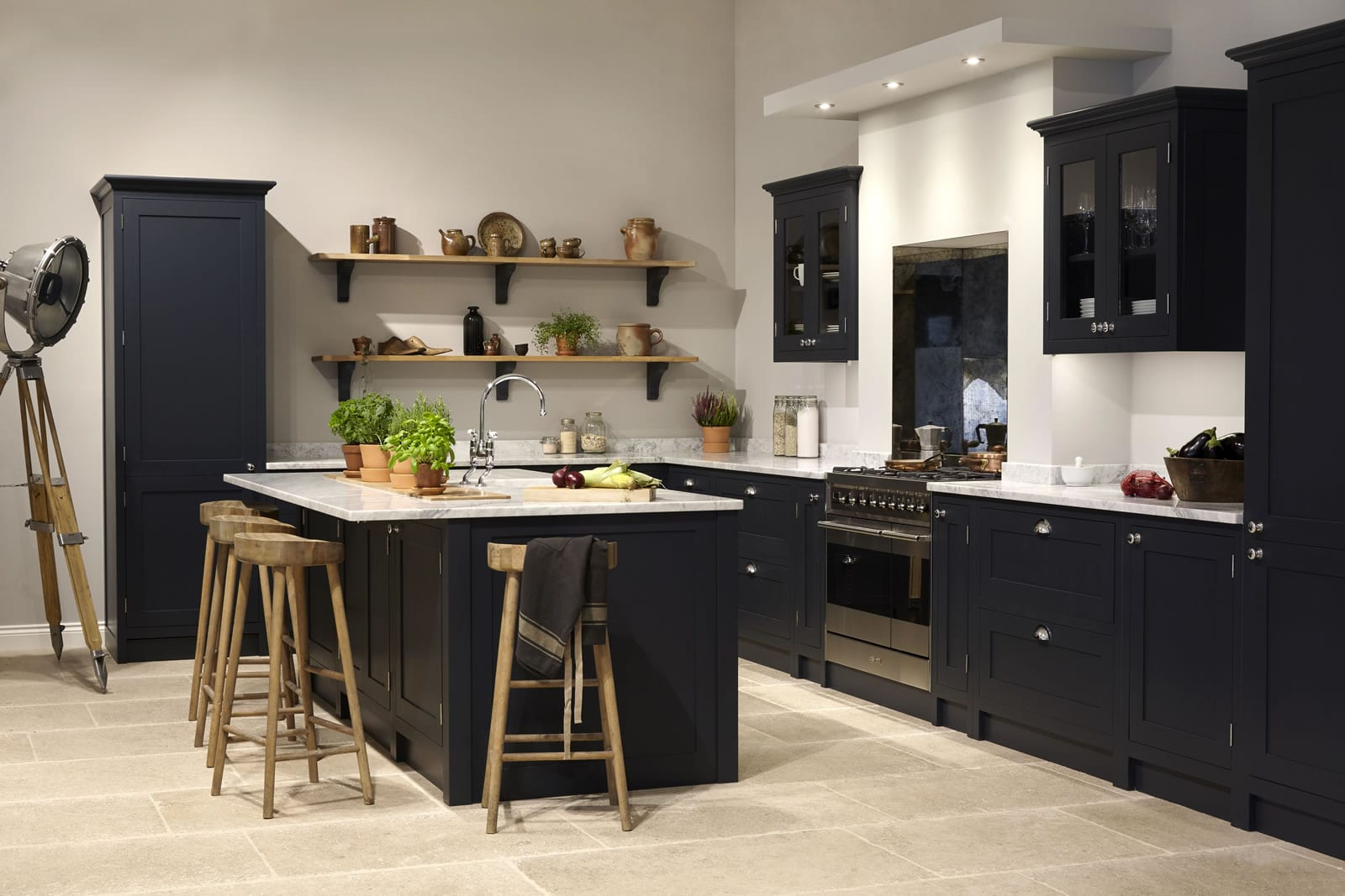 Navy Shaker kitchen showroom with white stone worktop and feature island