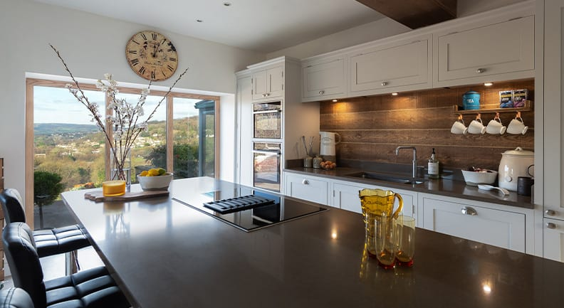 Large light grey shaker kitchen with big Island feature and large windows