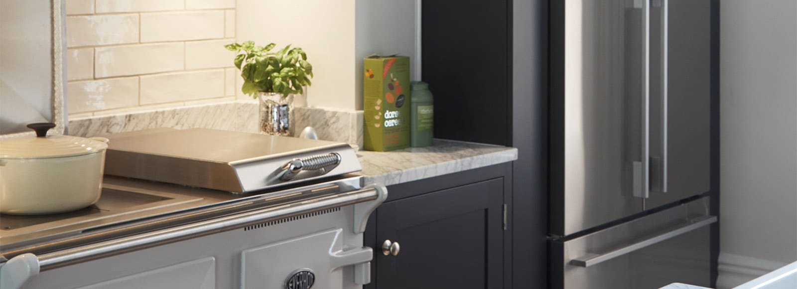 Close up of dark grey shaker kitchen with light grey oven and fridge