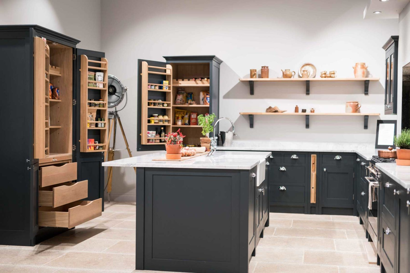 Olive & Barr Shaker kitchen with open cupboards and Island.