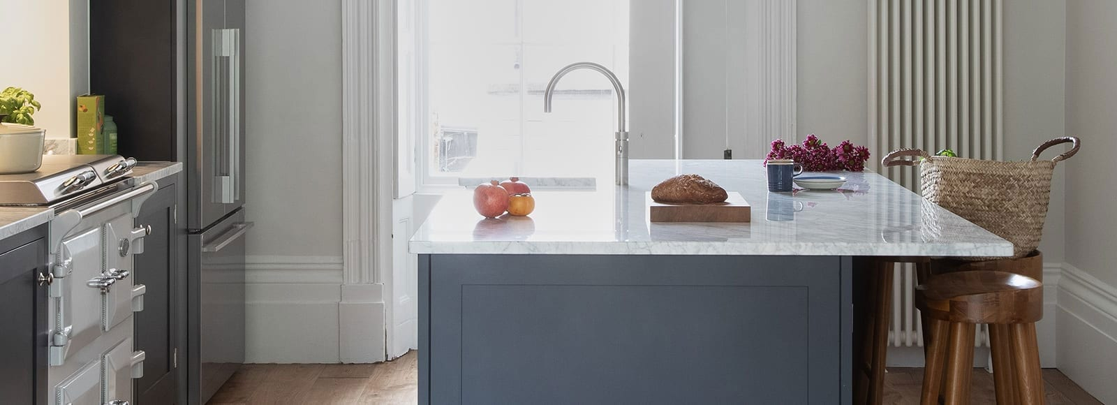 Shaker Kitchen island with granite worktop and silver features