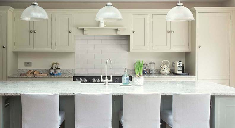 Custom green Olive & Barr shaker kitchen with stone worktop Island feature.