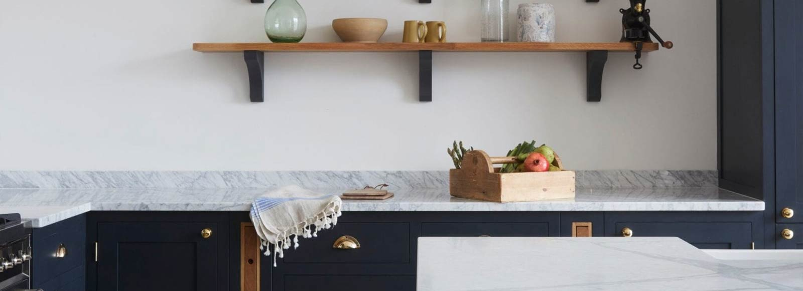 Navy blue shaker kitchen sideboard with wooden shelves